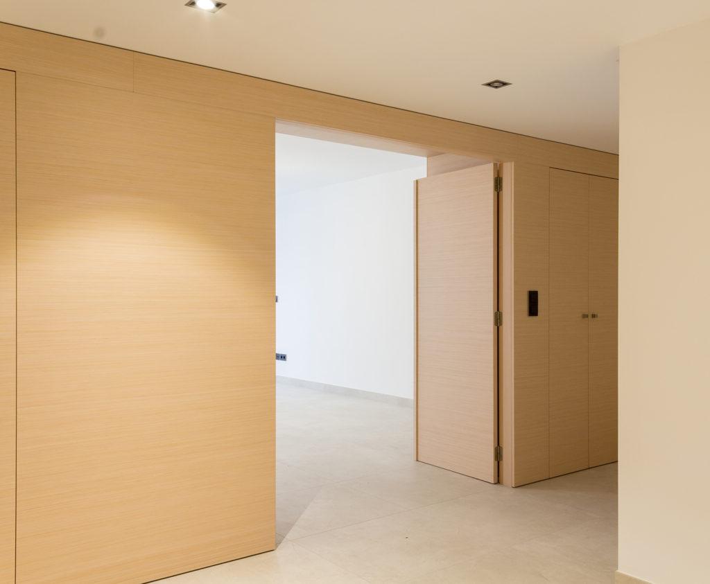 Reforma de oficina para su conversion en vivienda en Valencia revestimiento de madera